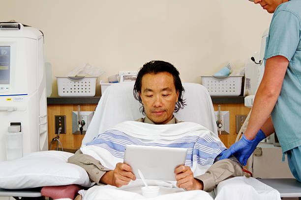 Asian patient receiving dialysis stock photo