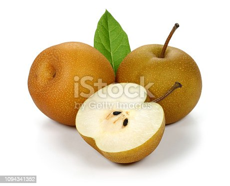 Group of asian pears on branch.