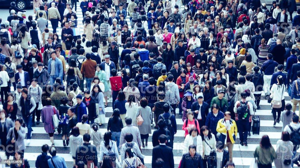 Asian People are across the crosswalk stock photo
