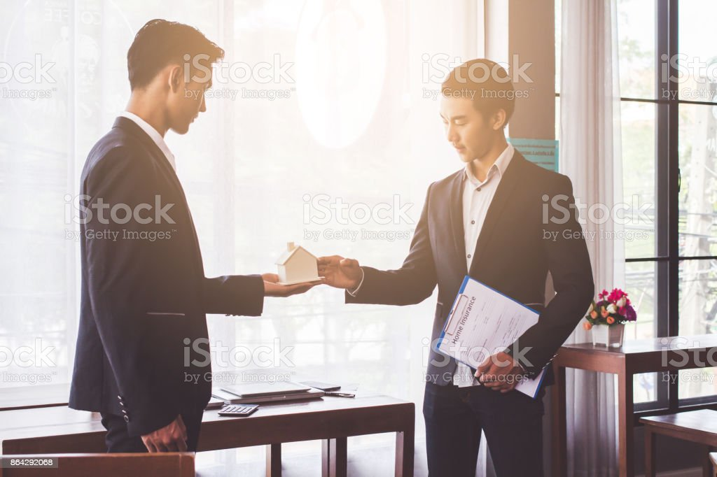 Asian people Giving new house in future success.business concept royalty-free stock photo