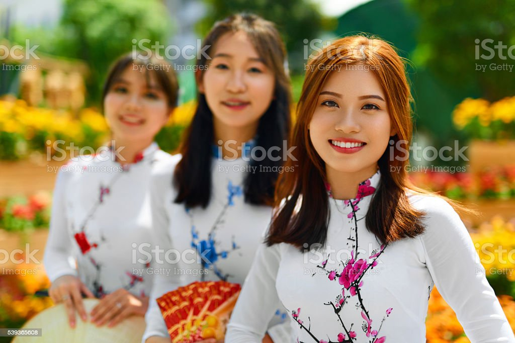 Asian People. Happy Women Wearing National Traditional Clothing. stock photo