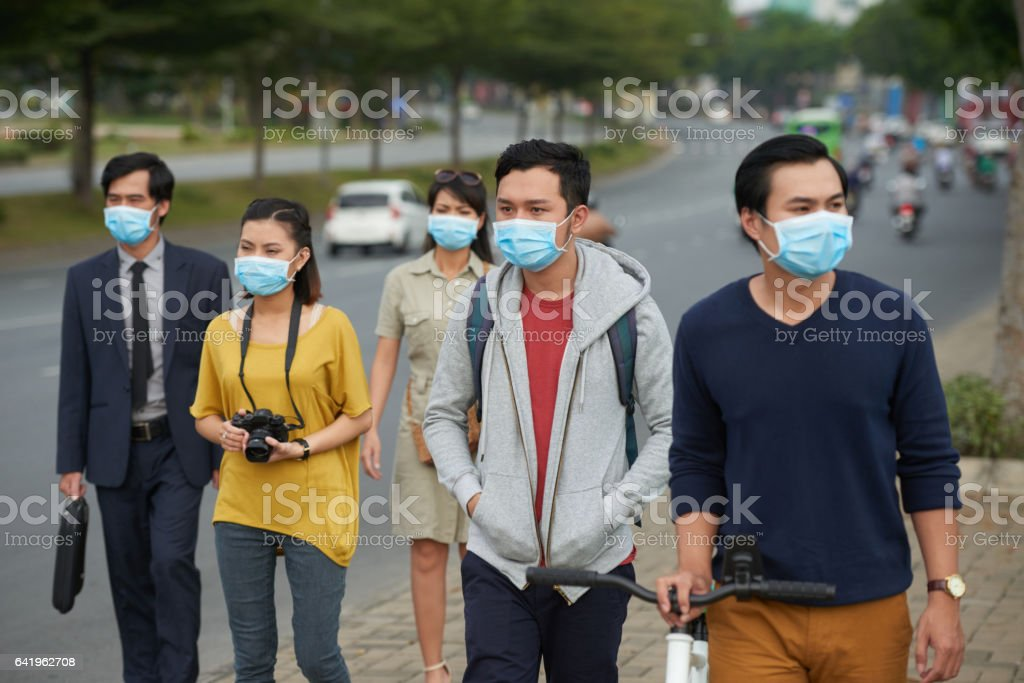 Asian people in medical masks stock photo