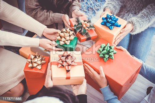 istock Asian people party celebrate christmas and new year eve in house. Man and woman giving gift box together 1173711885