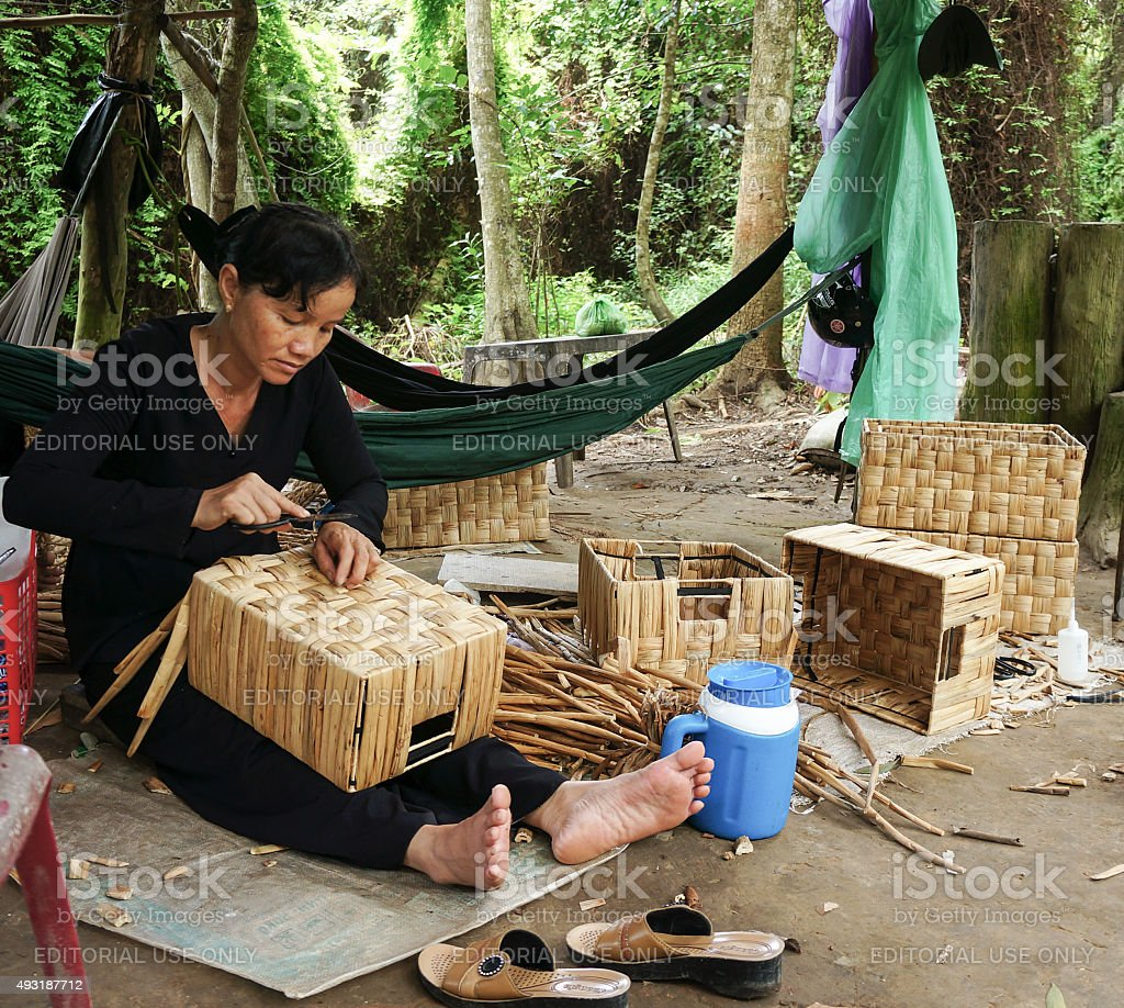 Asian people work inside coir mat workshop stock photo