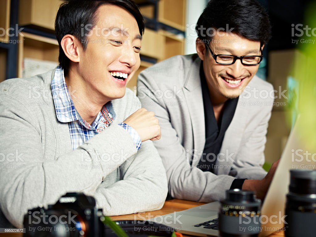 asian photographers at work stock photo