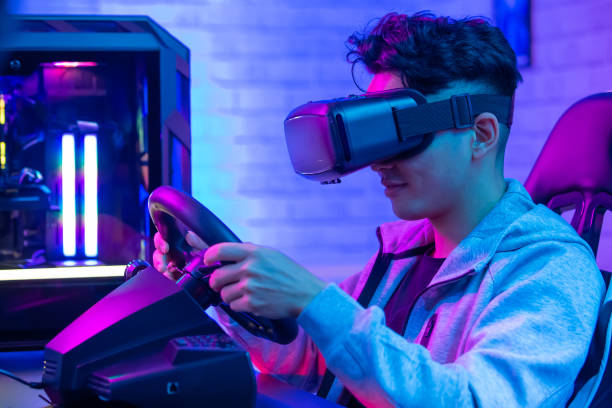 asian play game with vr asian gamer play car racing game with wearing vr glasses training equipment stock pictures, royalty-free photos & images
