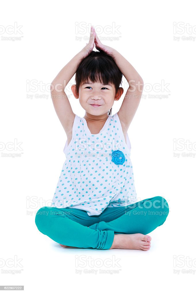 Asian pretty girl doing yoga exercises. Isolated on white backgr stock photo