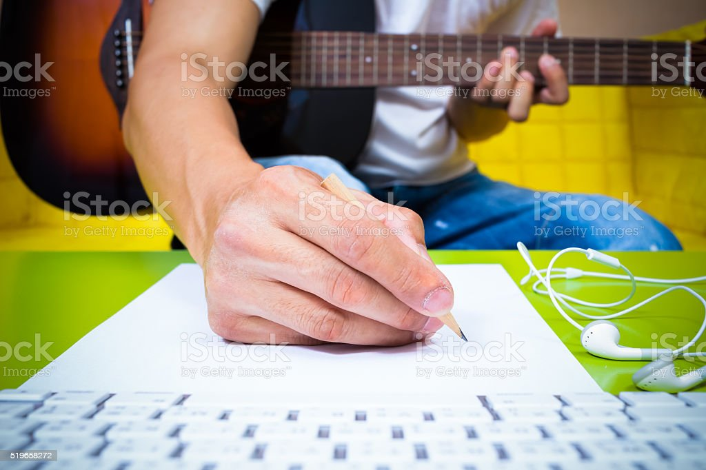 asian professional music composer hands writing songs stock photo