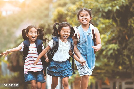 Back to school. Asian  pupil kids with backpack running and going to school together with fun and happiness in vintage color tone