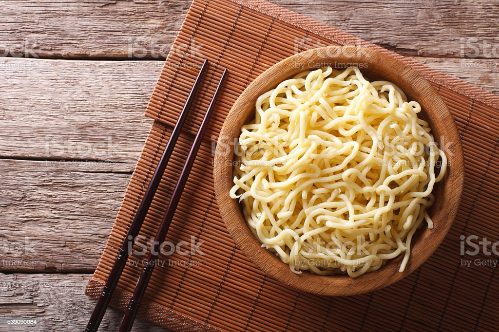 Asian ramen noodles in wooden bowl. horizontal top view stock photo