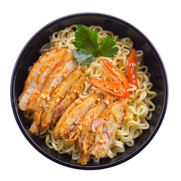 Asian ramen noodles with spicy thinly cut chicken stock photo