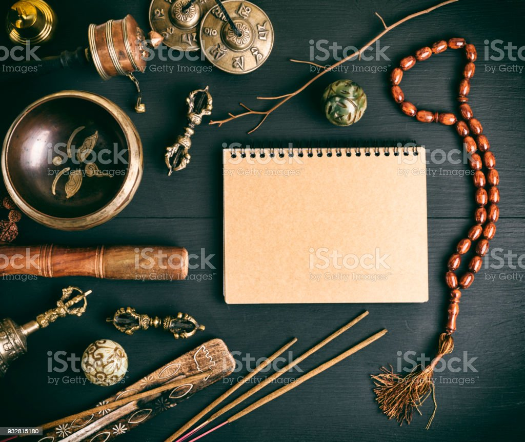 Asian religious musical instruments for meditation and notebook stock photo