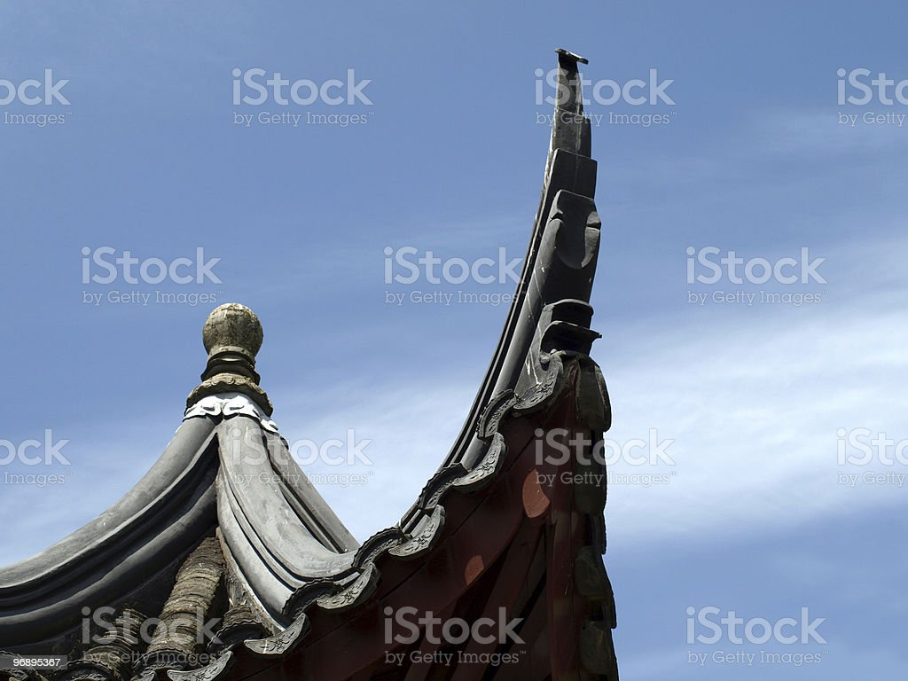 Asian roof on a blue sky royalty-free stock photo