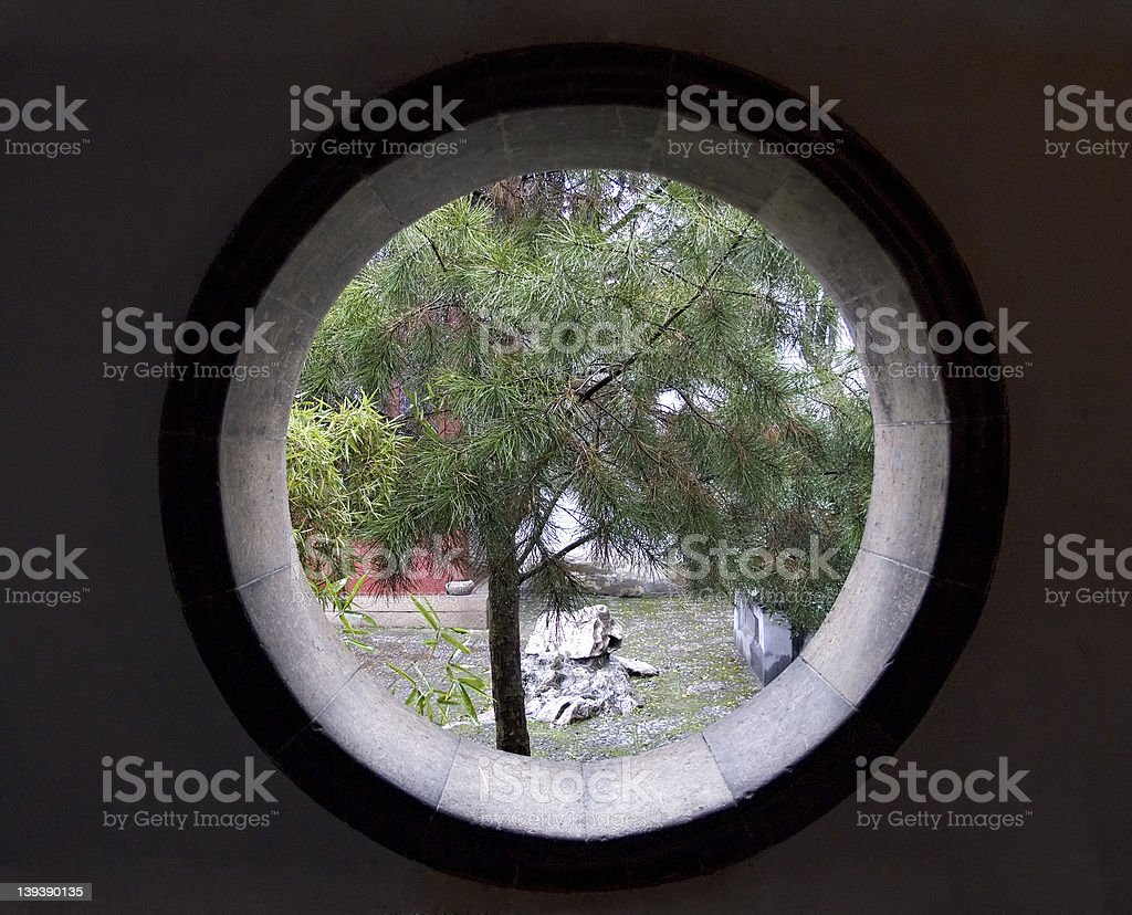 Asian round window into garden stock photo