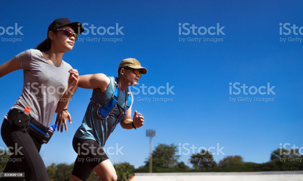 Asian Runner are rehearsing jogging, running on the pitch. stock photo