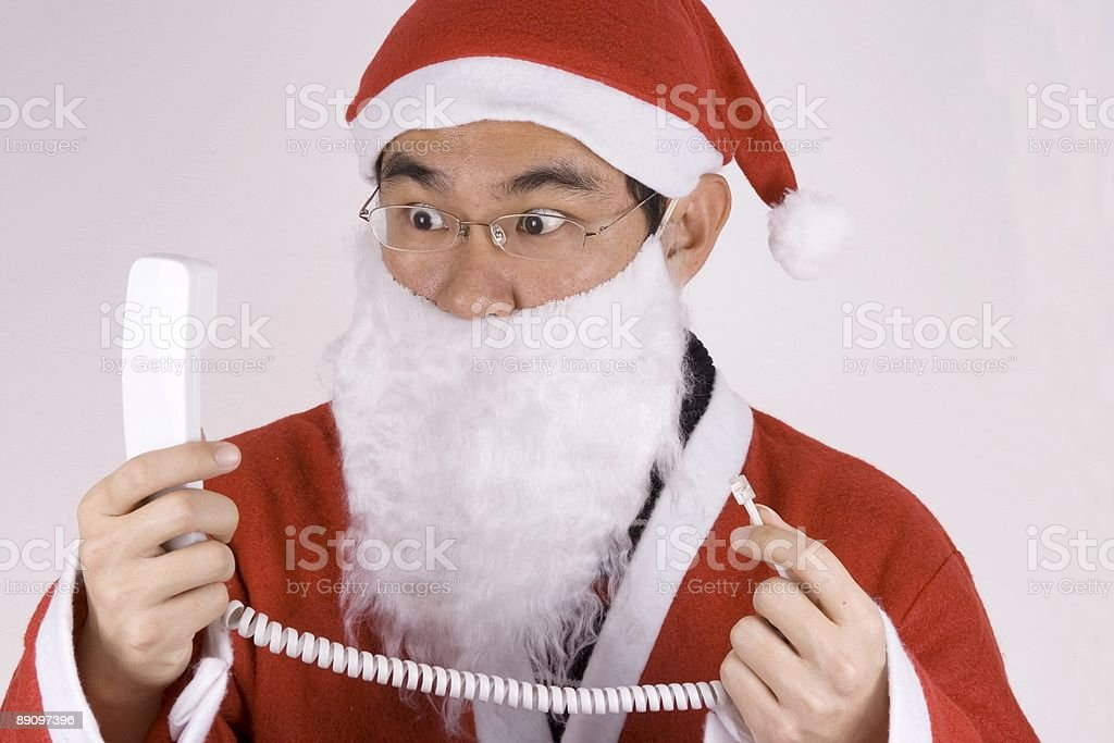 Asian Santa Claus With Telephone royalty-free stock photo