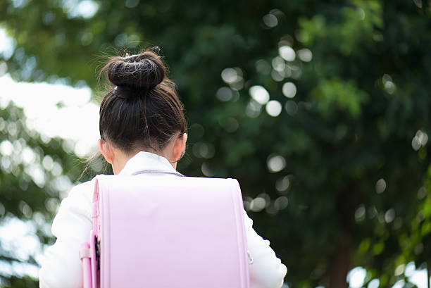 Asian school girl with pink backpack stock photo