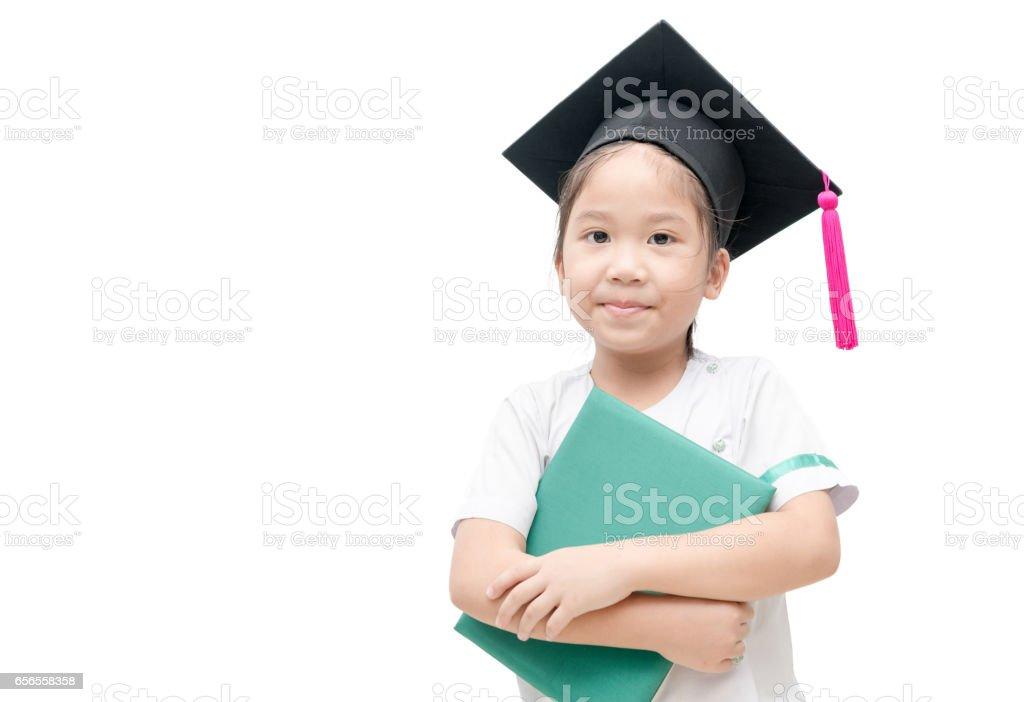 Asian school kid graduate with graduation cap stock photo