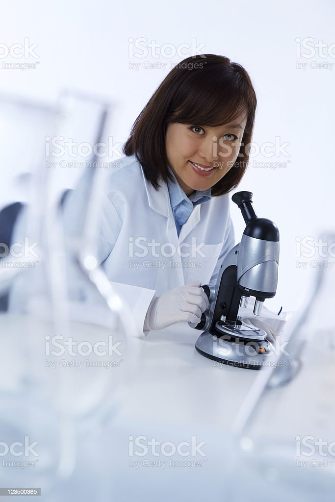 Asian Scientist Looking in a Microscope royalty-free stock photo