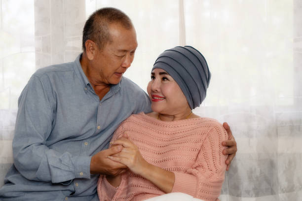 asian senior couple having encouragement when wife having cancer and being treat with chemotherapy asian senior couple having encouragement when wife having cancer and being treat with chemotherapy chemotherapy cancer stock pictures, royalty-free photos & images
