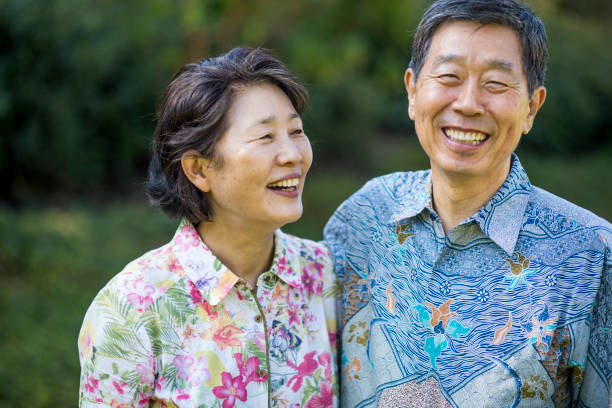 Asian Senior Couple A beautiful Asian senior couple smiling and enjoying life together korean ethnicity stock pictures, royalty-free photos & images