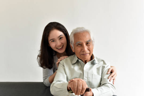Asian senior father and smiling daughter, Happy family relationship, Elderly home nursing care, Happy retirement concept. stock photo