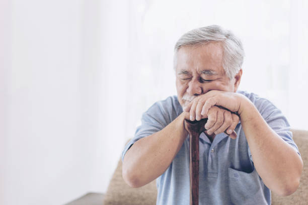 Asian senior man patients Toothache hurts - Elderly patients medical and healthcare concept stock photo
