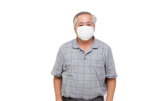 Asian senior man wearing a protective face mask for covid-19 infectious disease isolated on white background. Facial hygienic mask for safety outdoor environmental awareness or virus spread concept Asian senior man wearing a protective face mask for covid-19 infectious disease isolated on white background. Facial hygienic mask for safety outdoor environmental awareness or virus spread concept deathly stock pictures, royalty-free photos & images