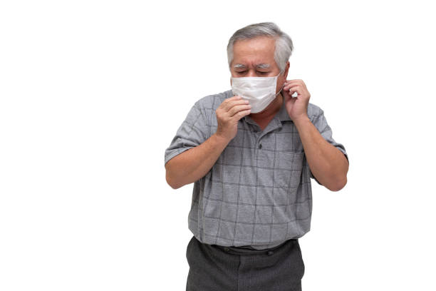Asian senior man wearing a protective face mask for plague coronavirus or covid-19 infectious disease. Facial hygienic mask for safety outdoor environmental awareness or virus spread concept Asian senior man wearing a protective face mask for plague coronavirus or covid-19 infectious disease. Facial hygienic mask for safety outdoor environmental awareness or virus spread concept deathly stock pictures, royalty-free photos & images