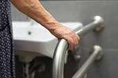 istock Asian senior or elderly old lady woman patient use toilet bathroom handle security in nursing hospital ward : healthy strong medical concept. 1248662076