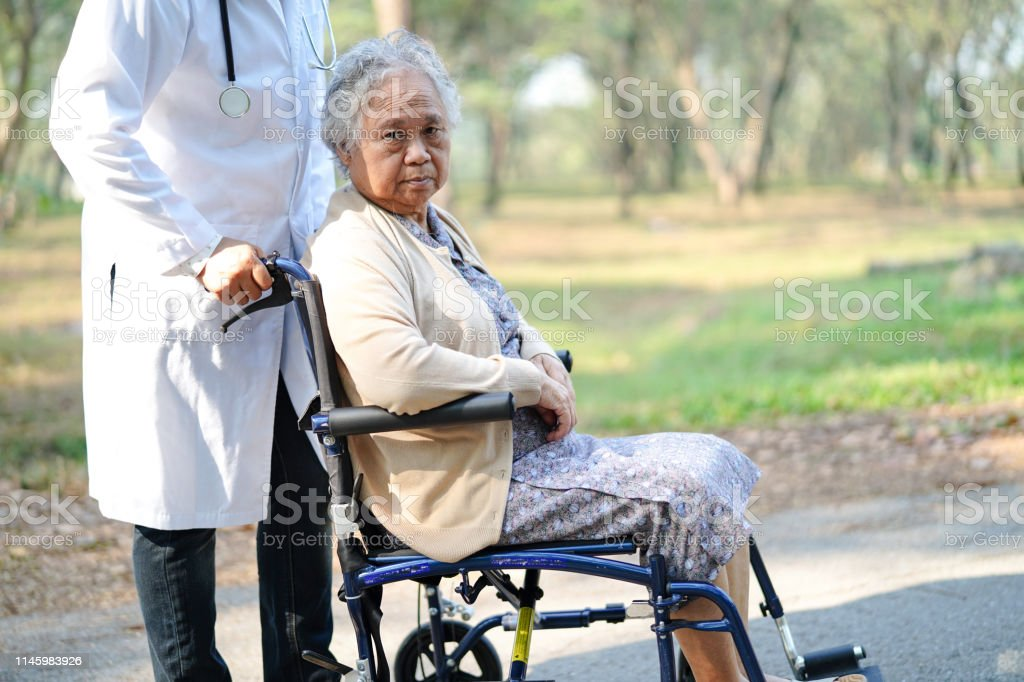 Asian senior or elderly old lady woman patient with care, help and...