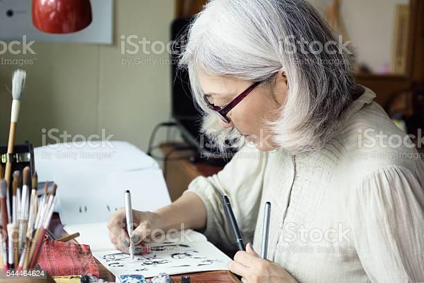 Asian senior woman artist sketching picture id544464624?b=1&k=6&m=544464624&s=612x612&h=b6ootxuol5wnll1yhfbzpkflkvp vfnqpgmclendeeg=