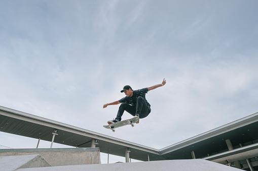 Asian skateboarder in action