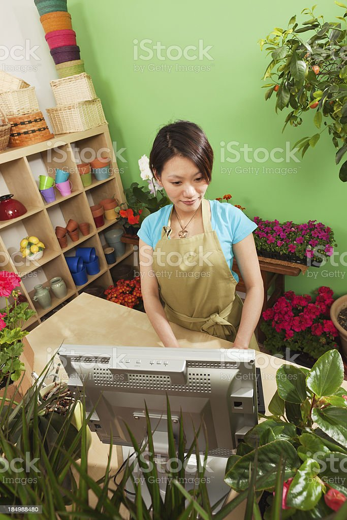 Asian Small Business Flower Shop Entrepreneur Working in Store royalty-free stock photo