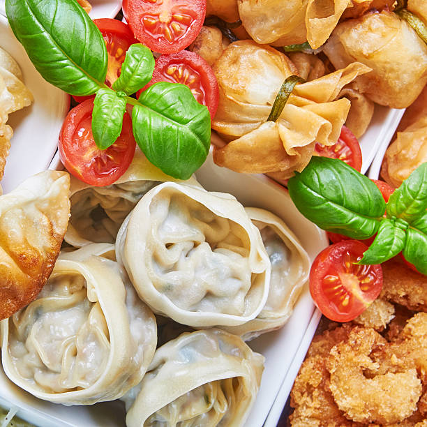 Asian snacks in white bowls stock photo
