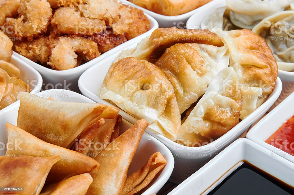 Asian snacks in white bowls stock photo