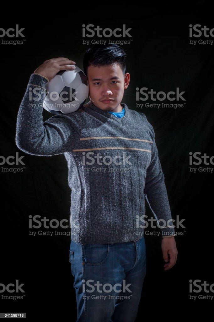 asian soccer mania man on black stock photo