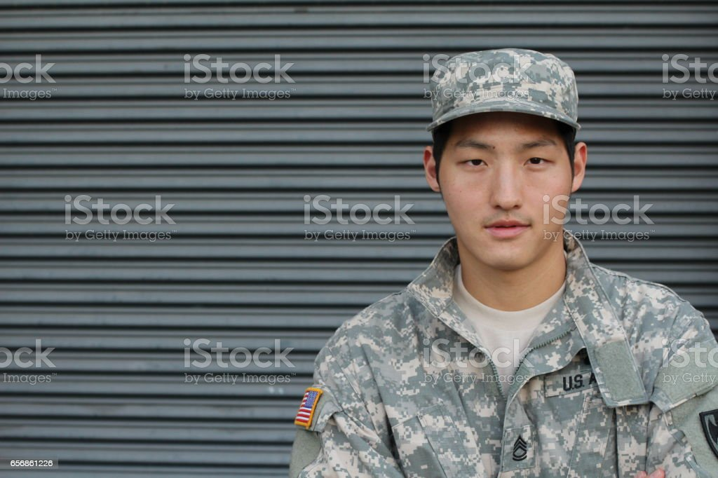 Asian Soldier in camouflage uniform stock photo