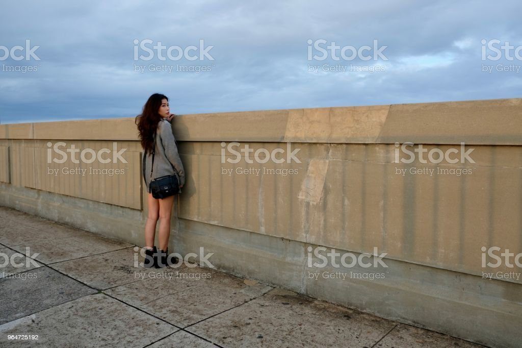 Asian standing on bridge against sky. royalty-free stock photo