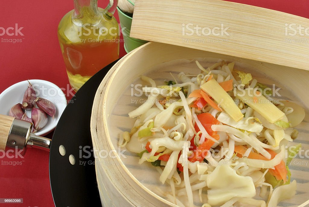 asian stir fry mix in a bamboo steamer royalty-free stock photo