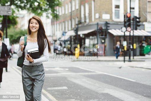 521911045istockphoto Asian Student Carrying Books 860794536