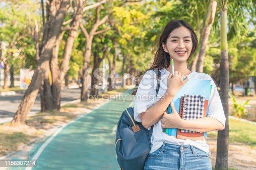 istock Asian student girl back to school university. 1156307214