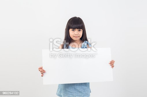 asian student girl holding a blank poster for text or ad.