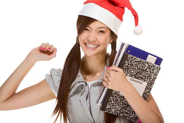 asian student girl in christmas santa hat with composition book - 18 23 months stock photos and pictures