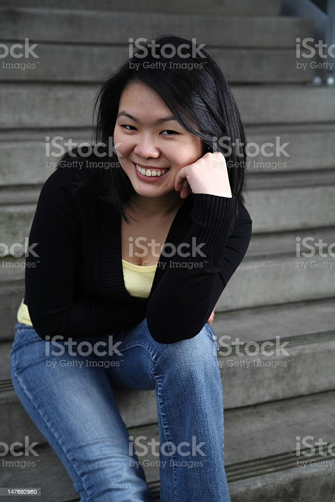 Asian student leaning forward stock photo