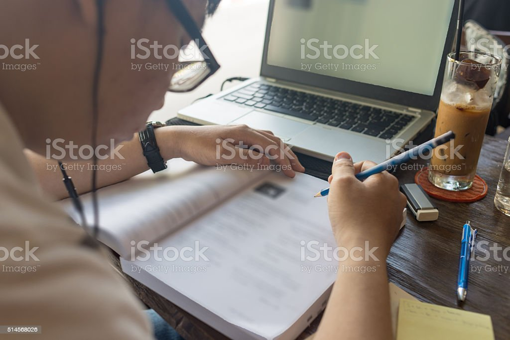 Asian student listenning the English question and answer into book stock photo
