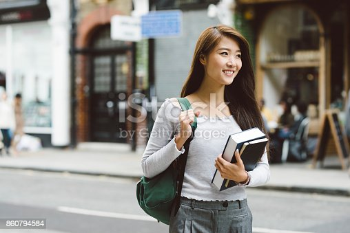 521911045istockphoto Asian Student on Her Way to Class 860794584