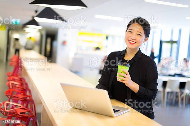 Asian student sitting at cafeteria with laptop and coffee picture id478949138?b=1&k=6&m=478949138&s=612x612&h=vbygyyuzfpznwxo k3dx jow5f fddcj4msw9grbtxm=