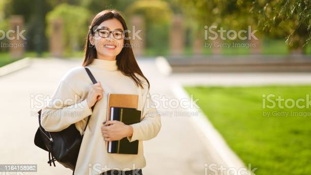 Asian student with backpack carrying books after study picture id1164158982?b=1&k=6&m=1164158982&s=612x612&h=83k713puqrzvr5p2cojiuif0vszebknu6nme4xx118k=