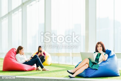 istock Asian students or business team sit together using laptop, digital tablet, smartphone in urban public space park. Modern casual office, Social media, wireless gadget, online shopping lifestyle concept 870648298